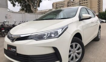 IMMACULATE CONDITION XLI MT 2018 WHITE COLOR, ONLY 65,000KM DRIVEN WITH 6 MONTHS OR 10,000KM WARRANTY ON ENGINE AND GEARBOX. full