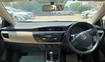 IMMACULATE CONDITION COROLLA GLI AT 2015,WHITE COLOR ONLY 72,000KM DRIVEN,WITH 6 MONTHS OR 10,000KM WARRANTY ON ENGINE AND GEARBOX. full