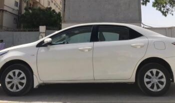 IMMACULATE CONDITION COROLLA GLI MT 2019, WHITE COLOR, ONLY 25,000KM DRIVEN,WITH 6 MONTHS OR 10,000KM WARRANTY ON ENGINE AND GEARBOX. full